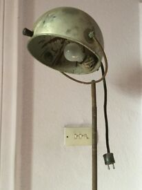 Retro industrial spot/workshop light. Metal shade, steel pole, metal wheel base. Needs renovation.