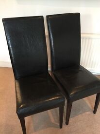 Dining Chairs X 4 Black leather with dark wood legs