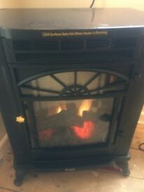 BiFlame Electric log effect heater. Used only 3 times . Controllable heat settings.