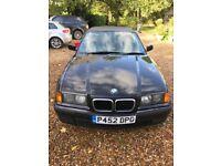 Good condition convertible Black BMW 318