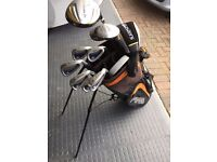 Set of RAM Wizard II golf clubs with Ping bag