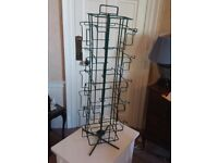 Table top green wire rotating book display stand