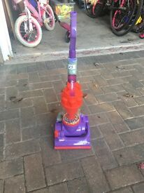 Kids purple dyson Hoover with accessories