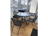 Round mosaic metal framed Conservatory or Patio dining table and three metal carver style chairs.
