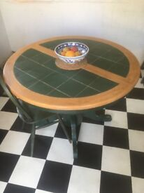 Wood & tiled round extendable table. Height 77cm. Extended 145cm 106cm. Closed 106cm, 106cm.