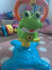 Vtech bounce and spin frog