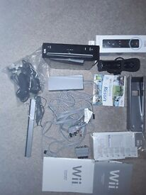 Nitendo Wii boxed with wii resort two contollers two numchucks