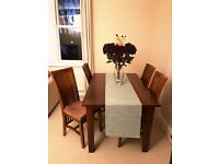 Beautiful solid wood dining table and matching chairs