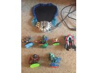 Skylanders portal, figures and bag.