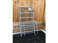 Metal bed with a pull out extra bed.