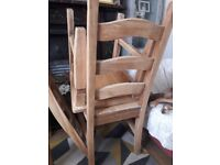 Solid pine stripped table and 4 highback chairs