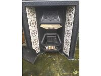 Victorian cast iron fireplace insert with tiles