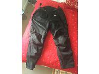 J&S motorbike trousers unused.
