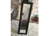 Brown stand up mirror