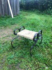 Outside seat made from old farm machinery