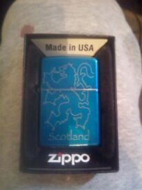 Zippo genuine lighter made in. blue can deliver scotkand lion text or phone if intrested brand new
