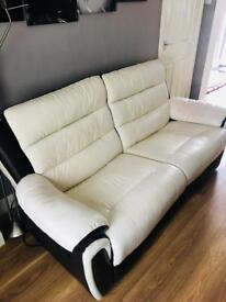Large 2 seater cream leather recliner couch.