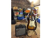 Fender Squire electric guitar with amp