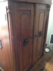 Lovely Asian Armoire used as a TV cabinet in dark wood, reluctant sale but need some space.