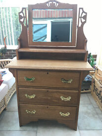 Solid oak carved old chest of drawers with decorative mirror