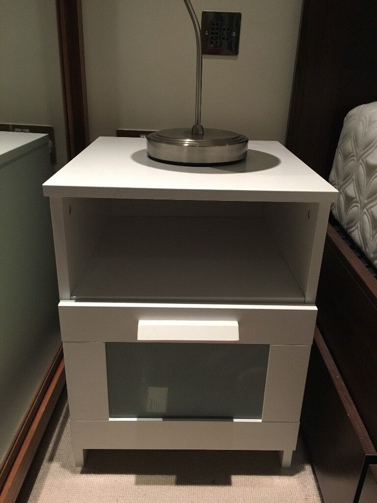 Two Ikea Brimnes bedside tables in white