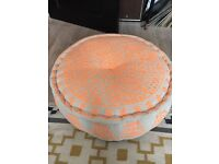 Neon coral embroidered pouffe