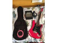 Electric guitar with amp, carry bag and cable