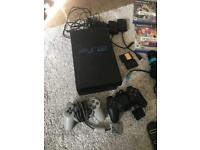 PlayStation 2 with singstar and buzz bundle