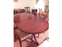 Walnut colour dining table and 8 chairs
