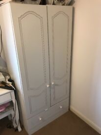 White 3 piece bedroom set. Wardrobe, 3 drawer chest of drawers and bedside unit.