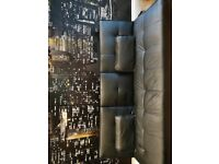 Black Faux leather sofa bed with drinks holders