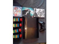 Slim line sony ps3 with call of duty 2, call of duty black ops and buzz quiz game and controllers