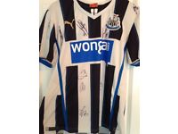 A Newcastle United signed shirt. Signed by the 2016-2017 first team including Rafa Benitez himself.