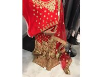 Unstitched indian red and gold bridal lengha