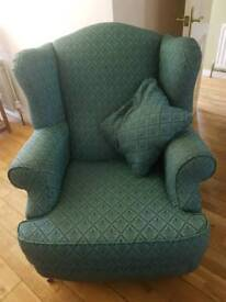 Green patterned wingback chair
