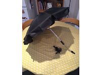 Black Universal Parasol would fit most prams and pushchairs.
