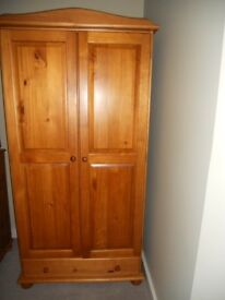 Pine wardrobe with drawers under