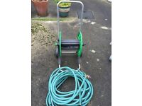 Hosereel holder on wheels with some hose