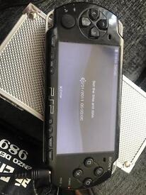 PSP with 2 games and case