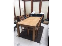 Solid oak dining table with oak upholstered chairs, a coffee table and lamp table