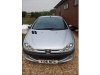 peugeot 206 convertible.black leather upholstery.