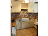 Cream fitted Kitchen for sale with butler sink hob solid wood top