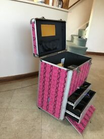 Large pink and black snake print beauty case with wheels and handle