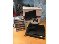 PS3 Slim 160GB with box,inc. wireless controller 15 games and cables