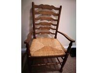 Two beautiful oak arm chairs