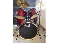 Pearl Drum kit: Includes all silencing drum pads, spare sticks and some drum theory books