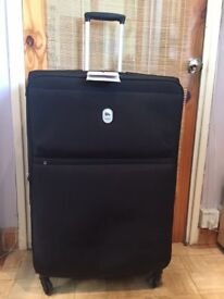 Large DELSEY suitcases on 4 wheels
