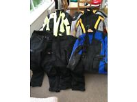A selection of motorcycle jackets and trousers