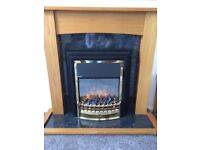 Wooden fire surround with electric fire, fire lights up independent from the heating