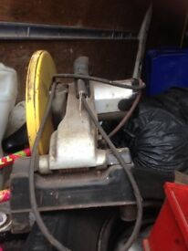 Chop saw good working order, large strong, yellow and gary in colour with a black base